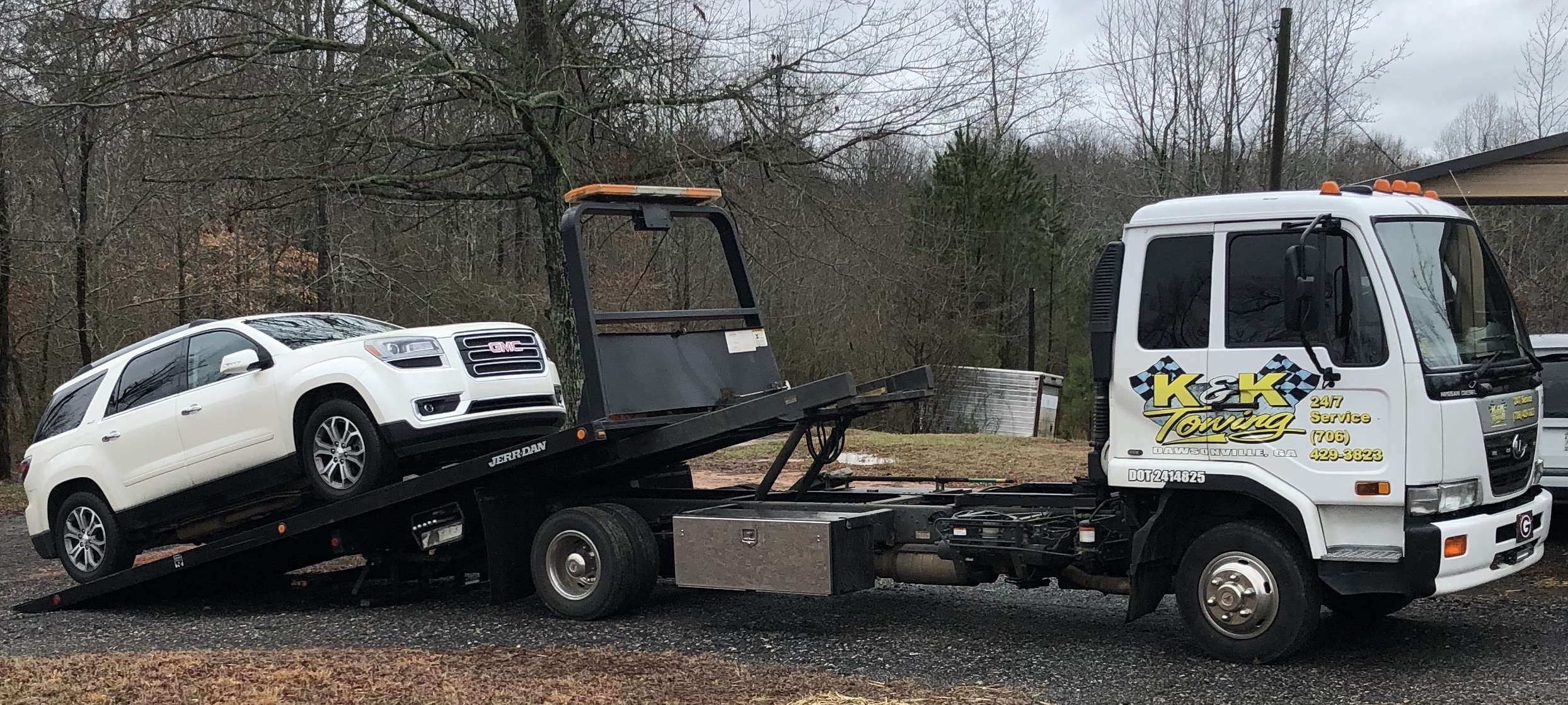 white GMC suv being loaded onto K&K Towing tow truck in Dawsonville, GA